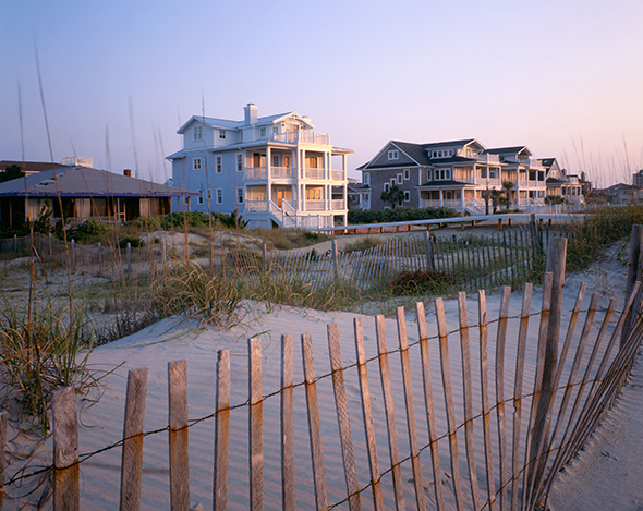 Beach houses at sunrise on the Atlantic Coast at Wrightsville Beach. (Photograph by Alamy via Beyond the Guidebook)
